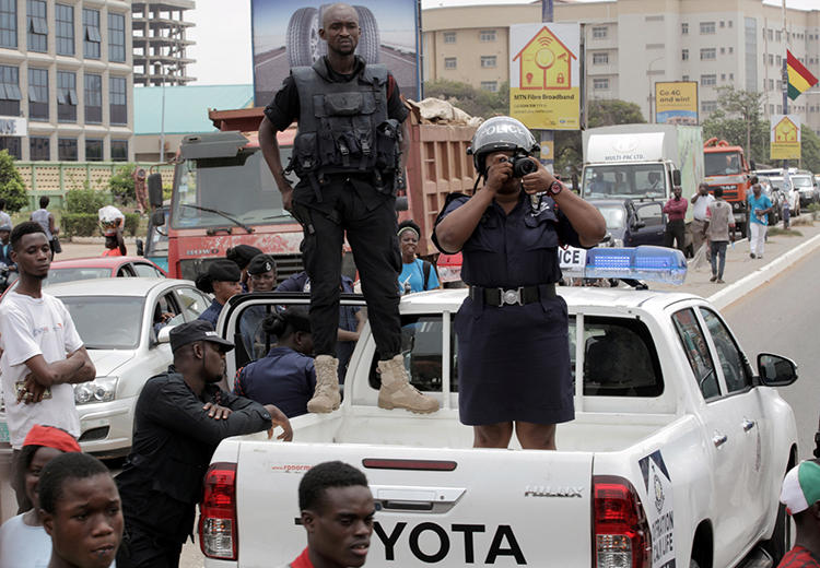 Police officers are seen in Accra, Ghana, on March 28, 2018. Police recently arrested Radio Tongu director Bestway Zottor, and authorities suspended the station's broadcast license. (Reuters/Francis Kokoroko)