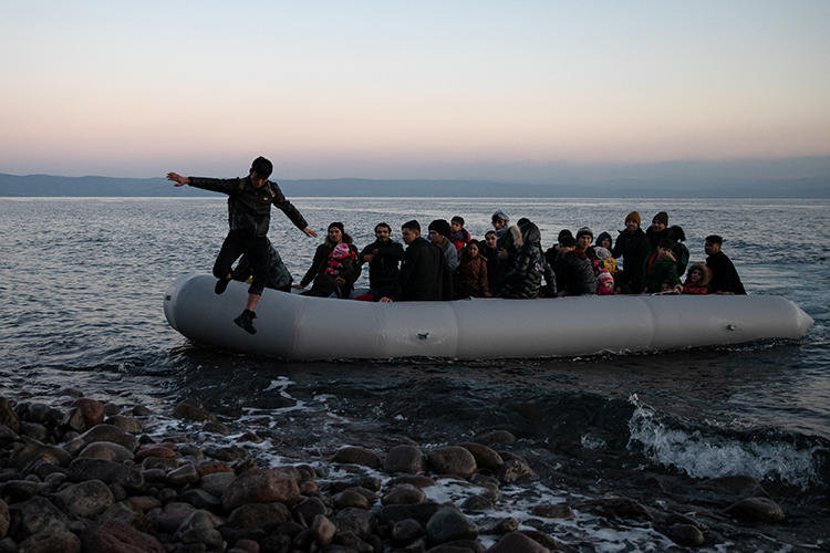 People from Afghanistan arrive on the island of Lesbos, in Greece, on March 2, 2020. Journalists covering the refugees' arrival were recently attacked by Greek protesters. (Reuters/Alkis Konstantinidis)