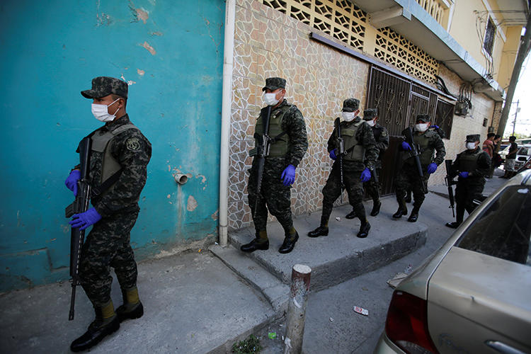 Soldiers wearing face masks are seen in Tegucigalpa, Honduras, on March 17, 2020. The Honduran government recently declared a state of emergency over the COVID-19 outbreak, and suspended the right to free expression. (Reuters/Jorge Cabrera)