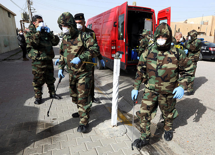 Members of a civil defense team disinfect the homes of people infected with coronavirus in Kirkuk, Iraq, on February 26, 2020. Security officers in Kurkuk recently confiscated the belongings of journalist Azad Shakur for allegedly violating a COVID-19 curfew. (Reuters/Ako Rasheed)