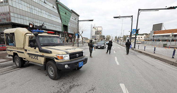 Security forces are seen in Sulaimaniya, Iraqi Kurdistan, on March 14. 2020. Unidentified individuals recently tortured and robbed journalist Adnan Rashidi in Iraqi Kurdistan. (Reuters/Ako Rasheed)