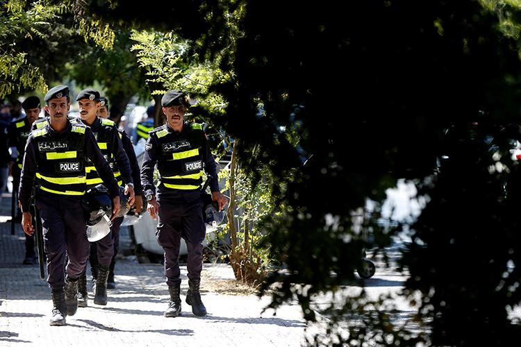 Police officers are seen in Amman, Jordan, on October 3, 2019. Jordanian journalist Hiba Abu Taha was recently charged with slander over a 2012 interview. (Reuters/Muhammad Hamed)