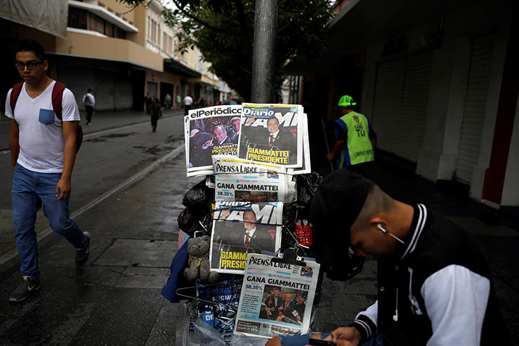 Newspaper headlines announce the election of Guatemala's new president, Alejandro Giammattei, on August 12, 2019.  A spokesperson for Giammattei says the administration is committed to transparency and making information available through a range of media outlets. (Reuters/Jose Cabezas)