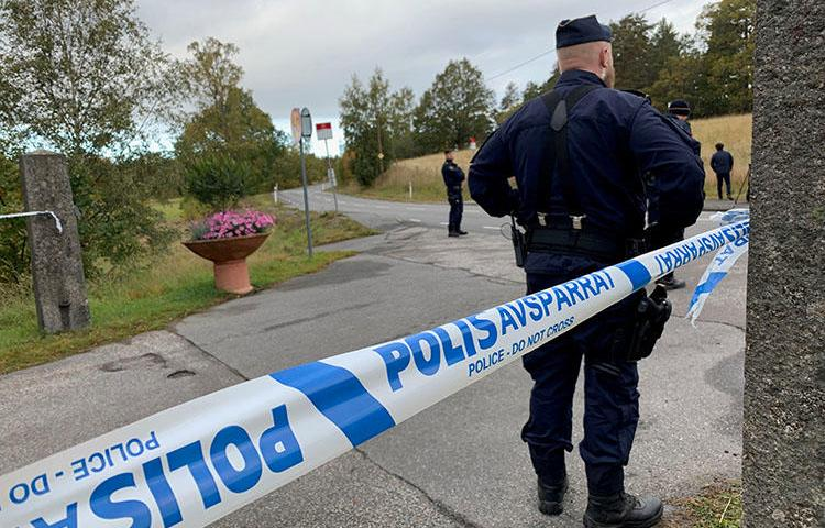 Police are seen outside Stockholm, Sweden, on October 5, 2019. Exiled Pakistani journalist Sajid Hussain Baloch recently went missing in Sweden. (Reuters/Anna Ringstrom)