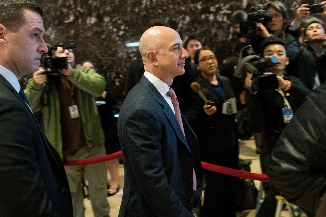 "Jeff Bezos, chief executive of Amazon and owner of The Washington Post, arrives for a meeting with then-President-elect Trump at Trump Tower in New York on December 14, 2016. The president has frequently referred derisively to ""the Amazon Washington Post.""  (Drew Angerer/Getty Images/AFP)"