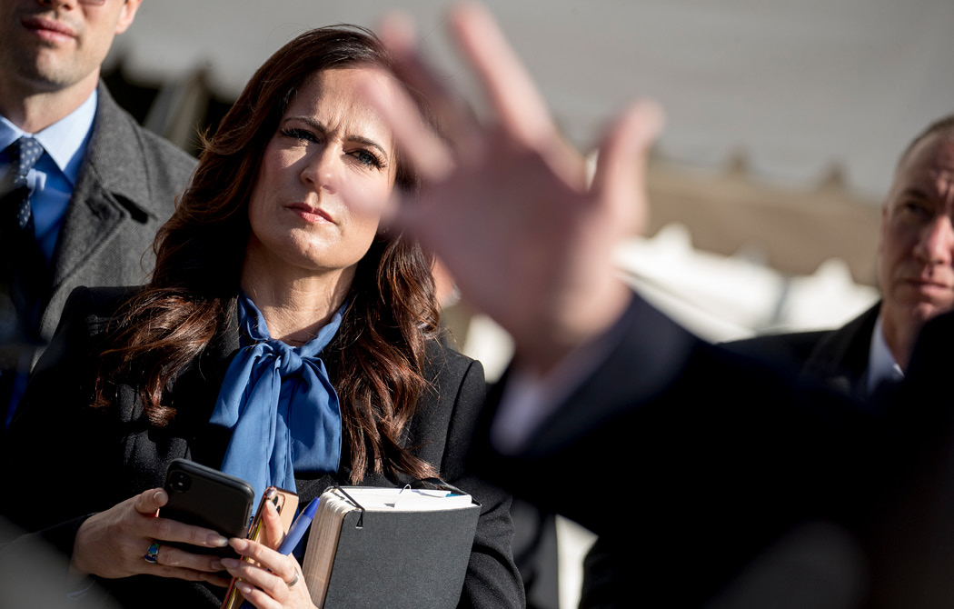 White House then-press secretary Stephanie Grisham listens as President Trump speaks to reporters on the South Lawn of the White House on November 8, 2019. Grisham did not hold a single press briefing during her nine months in the role. (AP/Andrew Harnik)