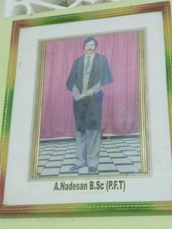 A framed photo shows Aiyathurai Nadesan, an award-winning journalist who was shot dead in Batticaloa in 2004. (CPJ/Aliya Iftikhar)