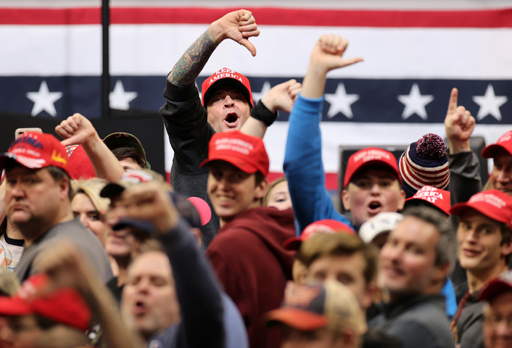 Trump supporters boo the media at a rally in Des Moines, Iowa, on January 30, 2020. Trump regularly taunts the press at his rallies, and encourages the crowd to join in. (Reuters/Jonathan Ernst)