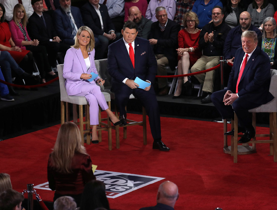Trump takes questions during a Fox News town hall with moderators Bret Baier and Martha MacCallum in Scranton, Pennsylvania, on March 5, 2020. Nearly half of the 70 interviews that Trump gave in 2019 were with friendly, right-leaning outlets, according to a count kept by CBS. (Reuters/Leah Millis)
