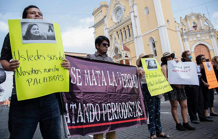 Journalists demonstrate against the killing of their colleague Maria Helena Ferral at Lerdo square in Xalapa, Veracruz state, Mexico on April 1, 2020. (AFP/Hector Quintanar)