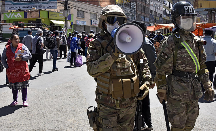 A military police officer is seen in El Alto, Bolivia, on April 3, 2020. Bolivia recently enacted a decree criminalizing 'disinformation' on the COVID-19 outbreak. (AFP/Aizar Raldes)