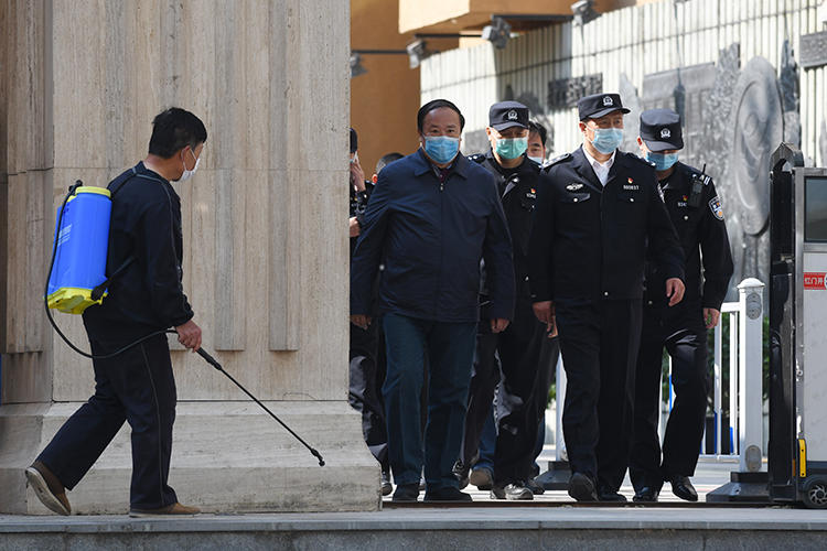 Police are seen in Beijing, China, on April 27, 2020. Police recently arrested two media workers in Beijing, and a third is missing. (AFP/Greg Baker)
