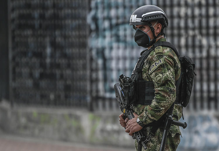 A police officer patrols the streets in Bogota, Colombia, on March 25, 2020. Colombian journalist Eder Narváez Sierra recently received death threats over his reporting. (AFP/Juan Barreto)