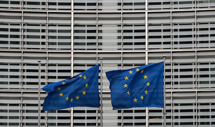 European Union flags fly during a special European Council summit in Brussels on February 21, 2020. (AFP/ Ludovic Marin)