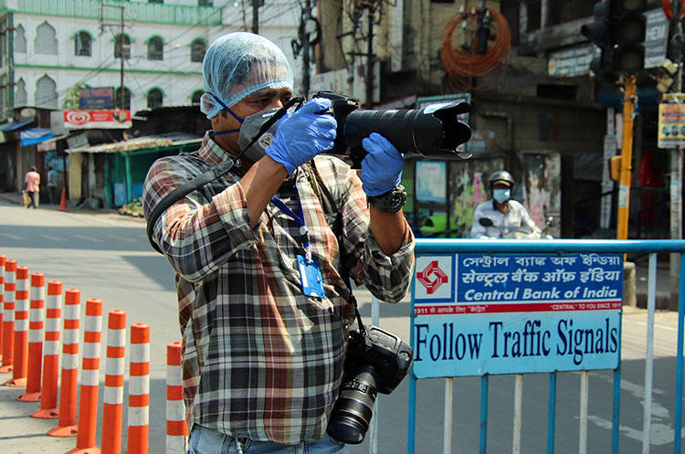 AFP photographer Diptendu Dutta works during a government-imposed nationwide lockdown as a preventive measure against the spread of COVID-19 in Siliguri, India, on April 10, 2020. Freelance journalists have faced risks to their lives and livelihoods amid the COVID-19 pandemic. (AFP)
