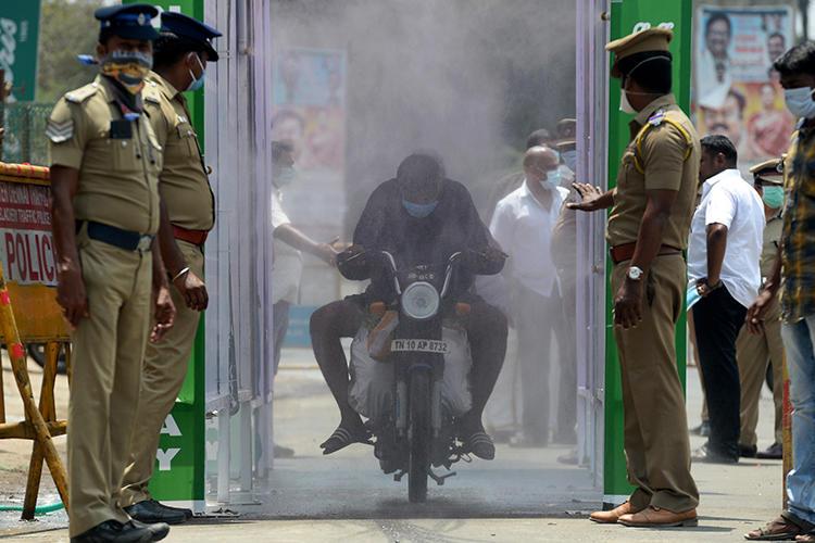 Police are seen in Chennai, Tamil Nadu state, India, on April 5, 2020. Tamil Nadu police recently arrested journalist Andrew Sam Raja Pandian. (AFP/Arun Sankar)