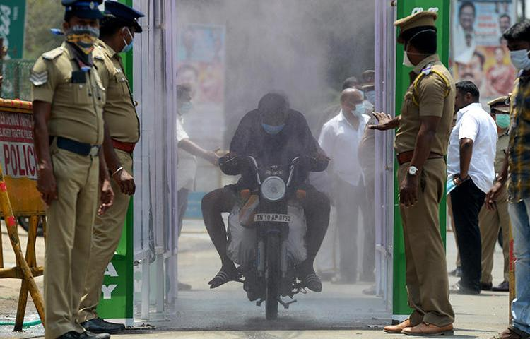 Police are seen in Chennai, Tamil Nadu state, India, on April 5, 2020. Tamil Nadu police recently arrested journalist Andrew Sam Raja Pandian. (AFP/Arun Sankar)