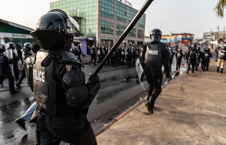 Police are seen in Monrovia, Liberia, on January 6, 2020. Security forces recently harassed and attacked at least four journalists in Liberia. (AFP/Carielle Doe)