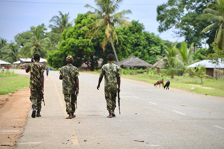 Soldiers are seen in Mocimboa da Praia, Mozambique, on March 7, 2018. Journalist Ibraimo Abú Mbaruco recently went missing in Mozambique. (AFP/Adrien Barbier)