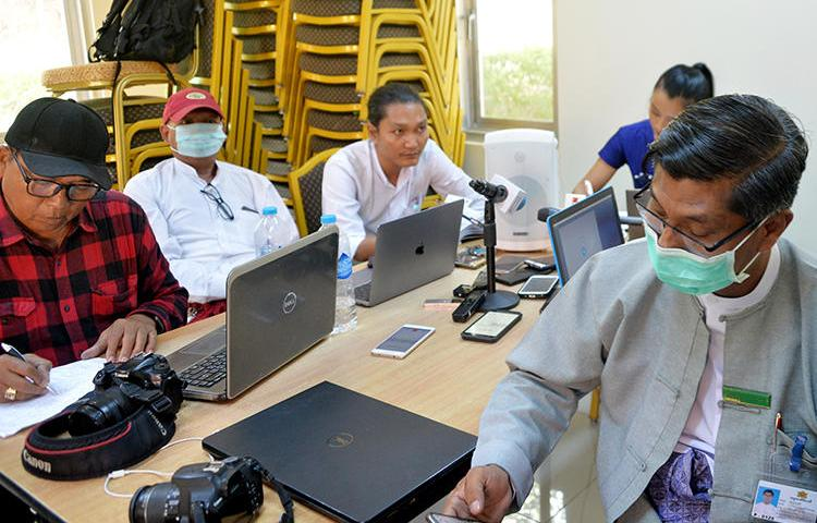 Journalists are seen in Naypyidaw, Myanmar, on March 13, 2020. The Myanmar government recently ordered dozens of news websites to be blocked. (AFP/Thet Aung)