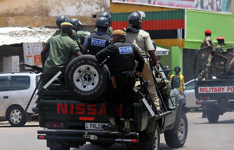 Police officers are seen in the streets of Lusaka, Zambia, on January 15, 2018. Zambia recently cancelled the license of the Prime TV broadcaster and police shuttered its office. (AFP/Dawood Salim)