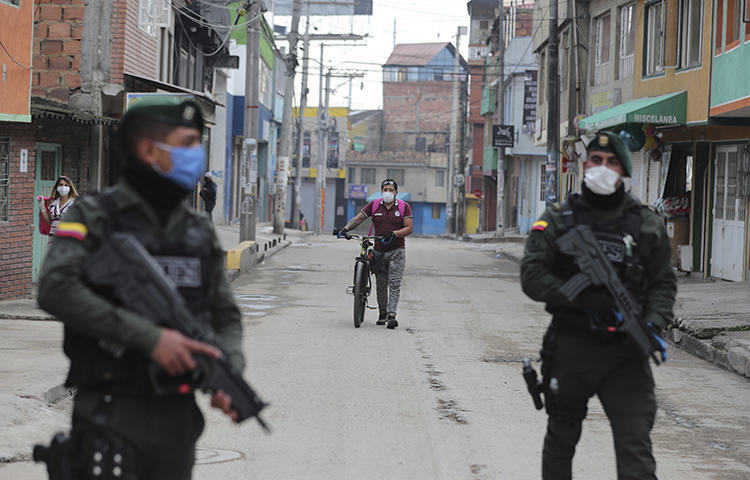 Police are seen in Bogota, Colombia, on March 25, 2020. Authorities recently suspended meetings of the country's journalist protection program amid fears of the COVID-19 pandemic. (AP/Fernando Vergara)