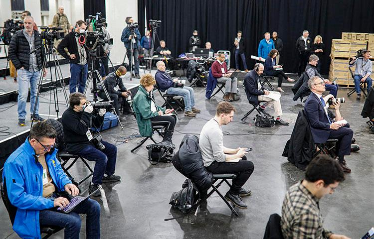 Journalists practice social distancing during a news conference with New York Gov. Andrew Cuomo at the Jacob Javits Center that will house a temporary hospital in response to the COVID-19 outbreak, on March 24, 2020, in New York. (AP Photo/John Minchillo)