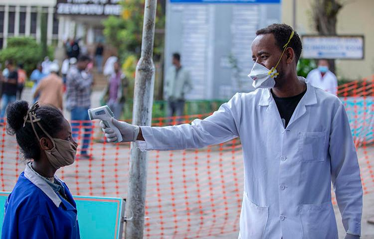 People have their temperatures checked at the Zewditu Memorial Hospital in Addis Ababa, Ethiopia, on March 18, 2020. Journalist Yayesew Shimelis was recently detained over a report about the pandemic. (AP/Mulugeta Ayene)