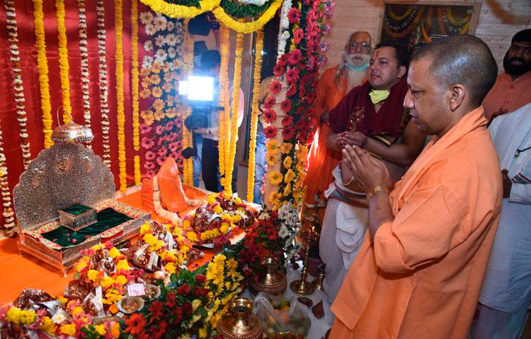 Chief Minister of Uttar Pradesh state Yogi Adityanath prays in Ayodhya, India, on March 25, 2020. Police in the state launched a criminal investigation into the editor of The Wire for his reporting on the ceremony. (AP/Amar Kumar)