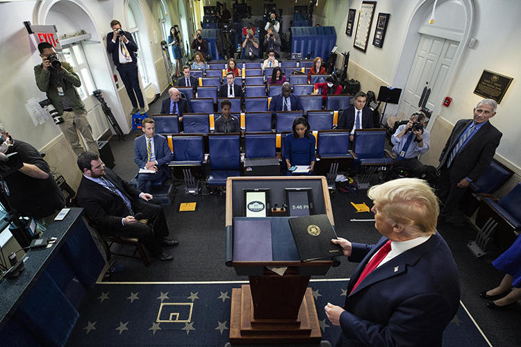 """President Donald Trump is seen in the James Brady Press Briefing Room of the White House on April 8, 2020, in Washington. The White House recently accused the Voice of America broadcaster of promoting """"foreign propaganda."""" (AP/Alex Brandon)"""