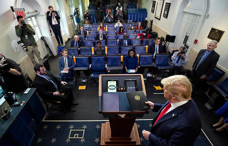 "President Donald Trump is seen in the James Brady Press Briefing Room of the White House on April 8, 2020, in Washington. The White House recently accused the Voice of America broadcaster of promoting ""foreign propaganda."" (AP/Alex Brandon)"