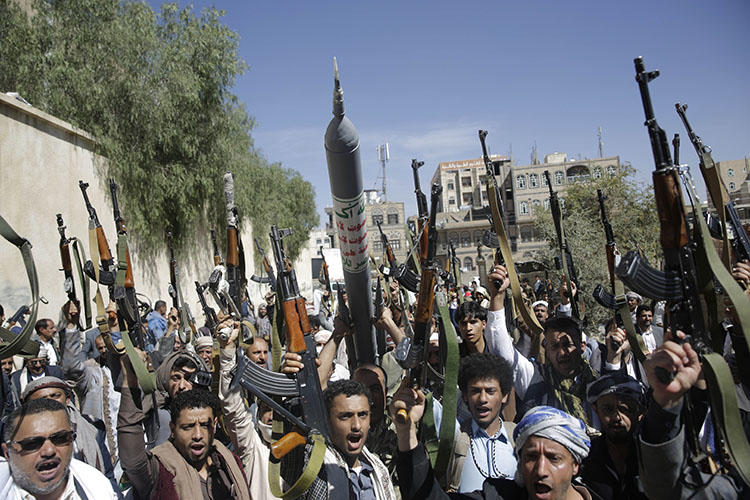 Tribesmen loyal to the Houthi rebel group raise their weapons as they chant slogans during a gathering aimed at mobilizing more fighters for the Houthi movement in Sanaa, Yemen, on February 25, 2020. The Houthis sentenced four journalists in their custody to death on April 11, 2020. (AP Photo/Hani Mohammed)