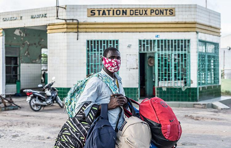A vendor wears a mask as a preventive measure against the spread of the COVID-19 coronavirus in Cotonou on April 8, 2020. CPJ and partner organizations called for the release of Beninese journalist Ignace Sossou on appeal. (Yanick Folly/AFP)