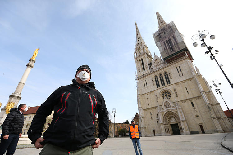 Croatian President Zoran Milanovic is seen in front of a cathedral in Zagreb on March 22, 2020. Two journalists were recently attacked while covering a Mass held against the COVID-19 lockdown in Croatia. (Reuters/Antonio Bronic)