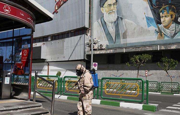 A volunteer sprays disinfectant in Tehran, Iran, on April 3, 2020. Authorities recently detained journalist Gholamreza NoriAlaa over a COVID-19 report. (West Asia News Agency)/Ali Khara via Reuters)