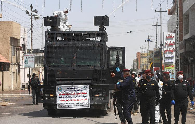 Police officers are seen in Basra, Iraq, on March 31, 2020. Police recently attacked journalist Mohamed Kader al-Samarrai at COVID-19 checkpoint in Samarra. (Reuters/Essam al-Sudani)