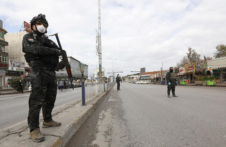 Security agents are seen in Sulaimaniya, Iraqi Kurdistan, on March 14. 2020. Regional authorities recently called for local broadcaster NRT to be closed. (Reuters/Ako Rasheed)