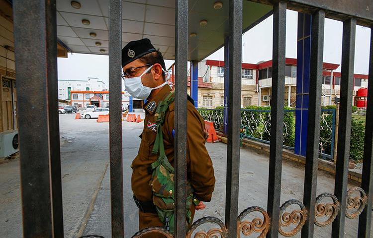 A security officer is seen in Najaf, Iraq, on February 24, 2020. Najaf-based reporter Ali al-Haj was recently threatened over his reporting. (Reuters/Alaa al-Marjani)