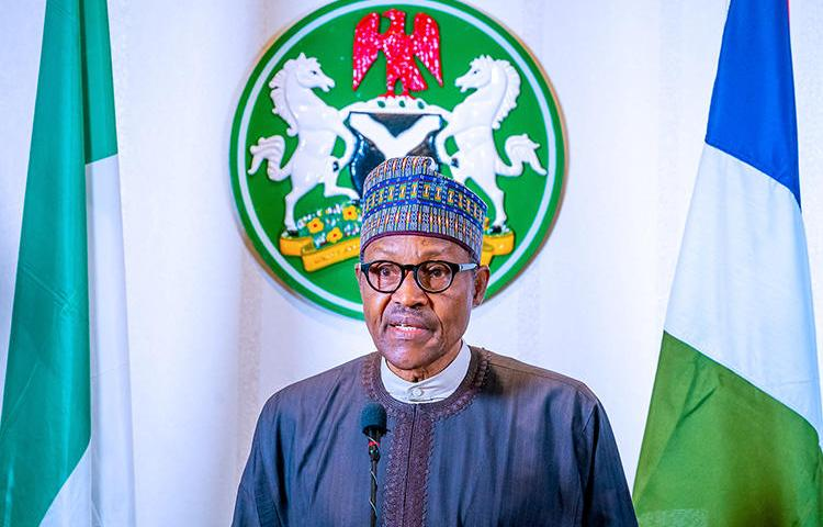 Nigerian President Muhammadu Buhari addresses the nation from Abuja on March 29, 2020. A team of journalists from Africa Independent Television were recently expelled from an event Buhari attended. (Nigeria Presidency/Handout via Reuters)