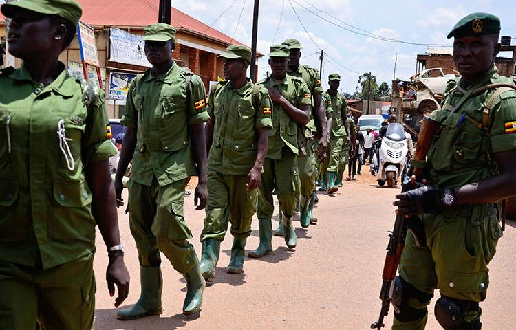 Security forces are seen in Kampala, Uganda, on April 4, 2020. Security forces throughout the country recently attacked and harassed journalists covering the COVID-19 pandemic. (Reuters/Abubaker Lubowa)