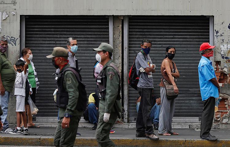 Members of the national guard are seen in Caracas, Venezuela, on April 3, 2020. National Guard officers recently arrested journalist Eduardo Galindo and his family. (Reuters/Manaure Quintero)
