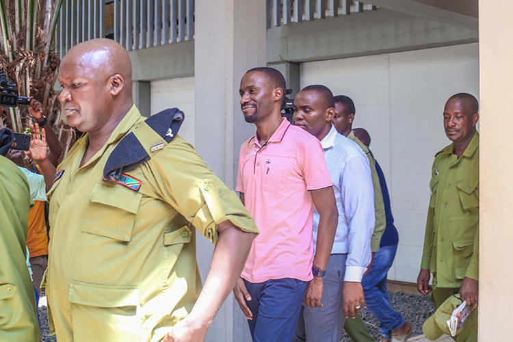 Maxence Melo leaves court in Dar es Salaam yesterday after being convicted of obstructing police investgiations. (Jamii Forums)
