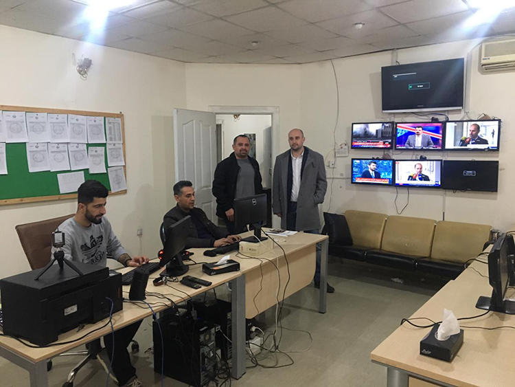 Sirwan Gharib (second from right) is seen in the Westga News office, in Sulaymaniyah, in February 2019. (Photo: Muhammad Tayib)