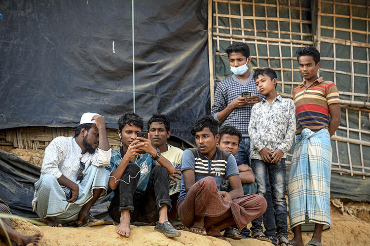 Rohingya refugees are seen in a camp in Cox's Bazar, Bangladesh, on December 11, 2019. CPJ recently spoke with refugee and journalist Ro Sawyeddollah about working in the camp. (AFP/Munir Uz Zamin)