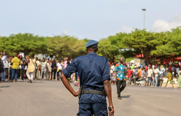 A police officer is seen in Cotonou, Benin, on March 9, 2018. A court recently shortened journalist Ignace Sossou's jail term, but did not free him. (AFP/Yanick Folly)