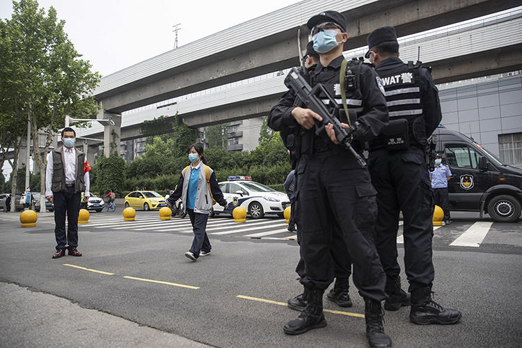 Police officers are seen in Wuhan, China, on May 6, 2020. Journalist Zhang Zhan recently went missing in Wuhan, and is now detained in Shanghai. (AFP)