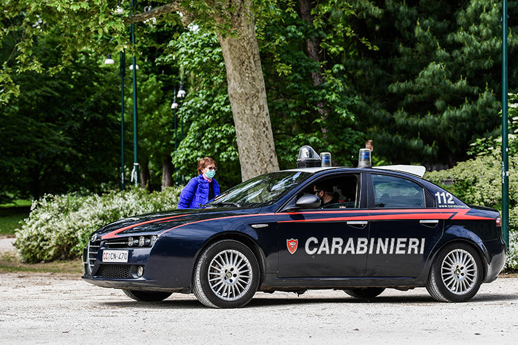 A police car is seen in Milan, Italy, on May 4, 2020. Unidentified attackers recently shot at Italian journalist Mario De Michele's home. (AFP/Miguel Medina)