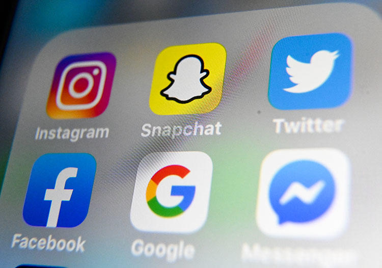 A picture taken on October 1, 2019, shows the logos of mobile apps Instagram, Snapchat, Twitter, Facebook, Google, and Messenger. (AFP/Denis Charlet)