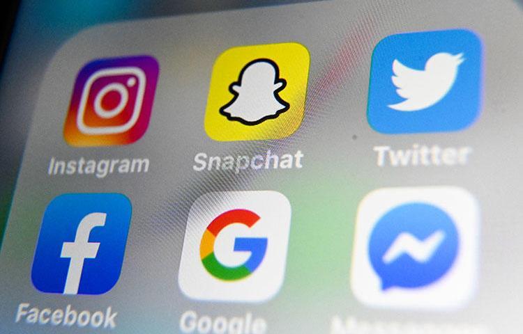 A picture taken on October 1, 2019, shows the logos of mobile apps Instagram, Snapchat, Twitter, Facebook, Google, and Messenger. (AFP/Denis Charlet)