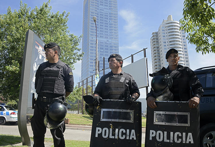Police are seen in Montevideo, Uruguay, on January 8, 2015. Proposed legislation in Uruguay's parliament would criminalize insulting the police. (AFP/Mario Goldman)